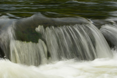I had always wanted to experiment with water, especially to get that amazing velvety effect with flowing water. There are a number of small rapids on the Rideau River at Hog's Back Park, just a few blocks from my apartment in Ottawa, that I have always been enthralled with. For a hand-held shot, I am quite pleased with the results.  Photo taken 2 August 2010.