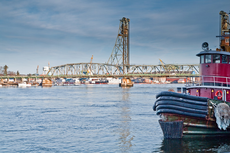 Tug, river and bridge. <br /> Portsmouth, NH