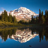 Mt. Rainier Reflection / Spray Park / Mt. Rainier National Park, Washington<br /> <br /> Spray park is an amazing place to be at this time of the year - wildflowers blooming all around the park. This is the west side of the mountain and gets the sunset light gleaming off its red rocks and glaciers. I went with my friend Ritesh to this spot just before sunset. We found this tarn just to the side of the park. The mosquitoes were having a feast here. Ritesh was busy spraying his body with insect repellents and shooing away the mosquitoes while I clicked. He loves hiking (read as he is trying to reduce his weight). He's a good friend and was willing to accompany me to the Park (a 3 mile hike) and back down when it was dark. I think that the sight was worth the effort and would definitely want to go back there again. He was on the lookout for Bears throughout our trek down back to the car :). More pics from Spray park to follow.
