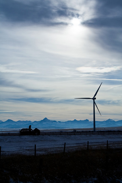 New wind turbine and an old farm equipment - near Pincher Creek, Alberta