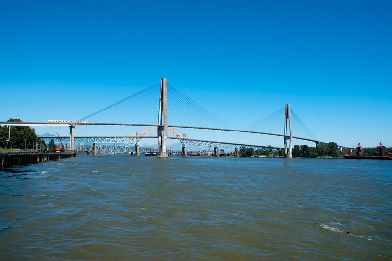 Skytrain and Pattullo bridges cross the Fraser River.