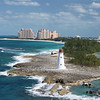 Lighthouse at entrance to Nassau Bahamas with Atlantis Resort in the background.