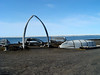 A view of the monument area of Barrow, Alaska.  In the view are the native skin whaling boats and a whale skull.