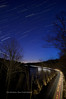Motion Nocturnal shows a star trail image with the movement of the French Broad River near Asheville, NC.  This is looking south from the Blue Ridge Pky overlooking Brevard Rd and the airport.