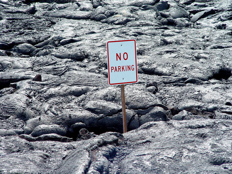 A sign from the old road got buried from a 1980's lava flow in Volcanos National park in Hawaii.