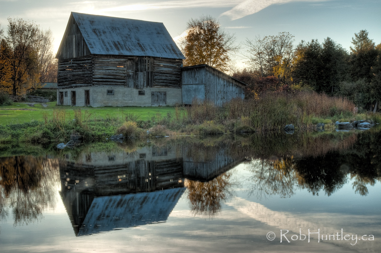 Barn reflection in a mill pond, Waba Creek, White Lake area, Ontario. HDR