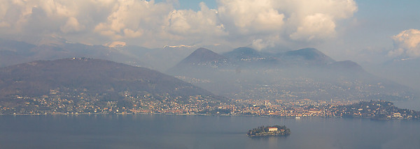 View to Lago Maggiore and Isola Madre. This photo is taken on a road to Mottarone. Road is winding up  and after half an hour there was already snow by the road. Very contrasting to the lakeside resorts with palms and araucarias.