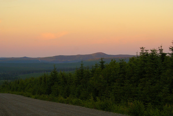 The setting sun shines one last time on the distant mountains.  This view was taken at the base of Mount Mitchell, along Kagoot Brook Road, facing southeast.  Photo taken 6 July 2010.
