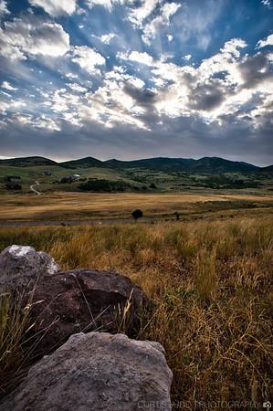 Rocky Grassland Sunset