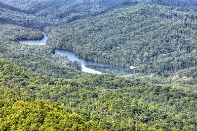 Fern Lake, KY.  On the top of the ridge (left of lake, not in this photo) is Tri State Park.  Here Kentucky, Tennessee, and Virgina come together.