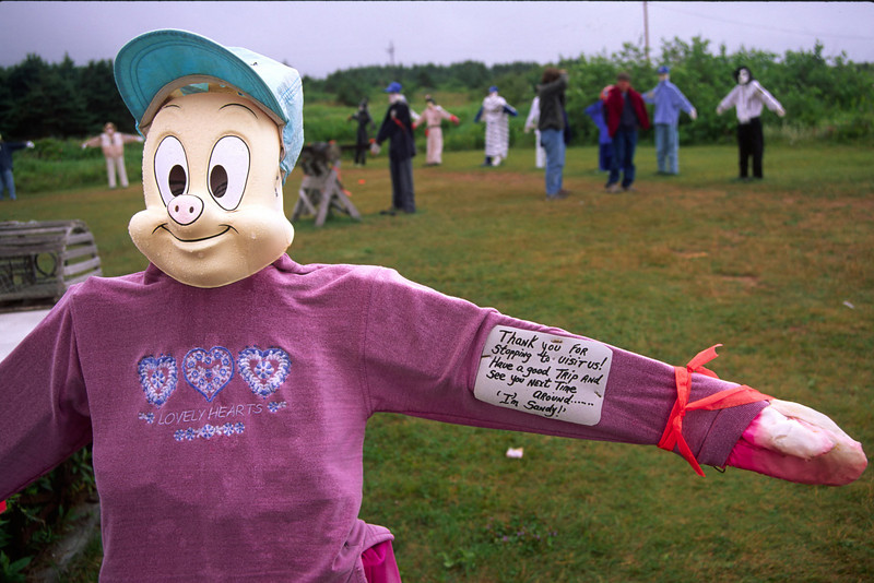 Homemade mannequins in yard on roadside in Cheticamp, Nova Scotia. Town is along the Cabot Trail