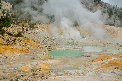 A tourquoise colored boiling lake is highlight of Bumpass Hell.