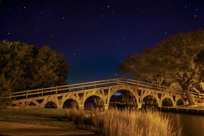 "Night time view of ""Golden Bridge"" at Heritage Park, Corolla"