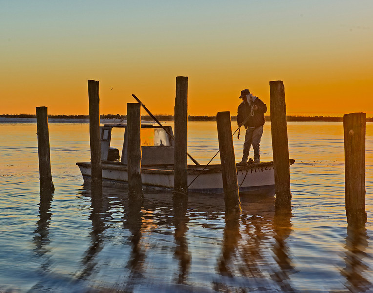 Start of another day on the water, oystermen prepare their boat in Eastpoint, FL