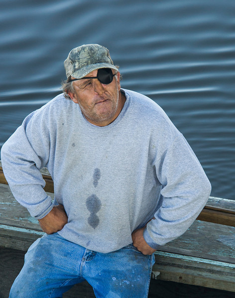 Taking a break, this oysterman takes a few minutes to talk about his work and the water around Apalachicola bay