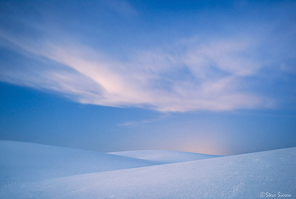 White Sand Blues<br /> <br /> I wanted to capture the mood of twilight here at White Sands. This was shot the day after the full moon so I waited until right before the moon came up to capture the last bit of ambient sunlight and then the moon popped and took away the natural vignetting you see in this shot.  Achieving an artistic look was what I was aiming for here.