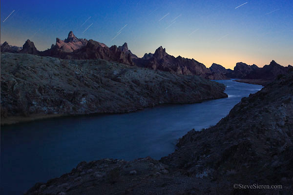 Nightfall on the Colorado River<br /> <br /> Volcanic Spires rise above the Colorado River in the Mojave Desert