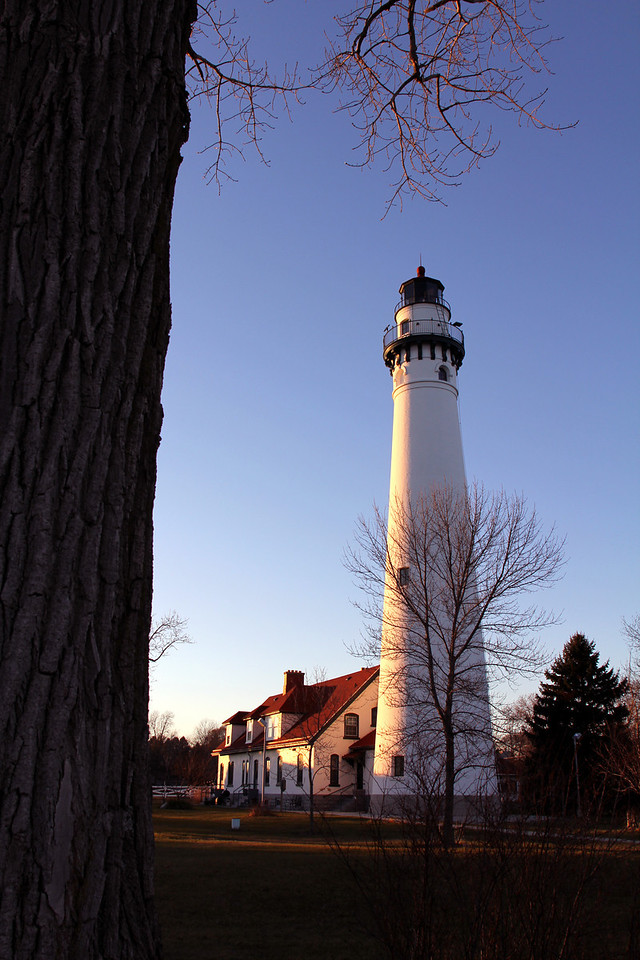 Wind Point. Wi<br /> <br /> To assist navigation around the point into Racine harbor, the Wind Point Lighthouse began functioning in 1880 with a kerosene lamp, focused and magnified by a third order Fresnel lens. Its light could be seen for 19 miles. <br /> At 108 feet, it is one of the tallest and oldest lighthouses still serving navigation on the Great Lakes. Its fog horns, which last sounded in 1964, could be heard for 10 miles. <br /> <br /> In recognition of the key role this lighthouse had played in the maritime history of Racine County, it was placed on the National Register of Historic Places in 1984. <br /> <br /> In 1997, the National Park Service awarded ownership of the property to the Village of Wind Point. The Coast Guard still maintains the light as a public navigation aid.