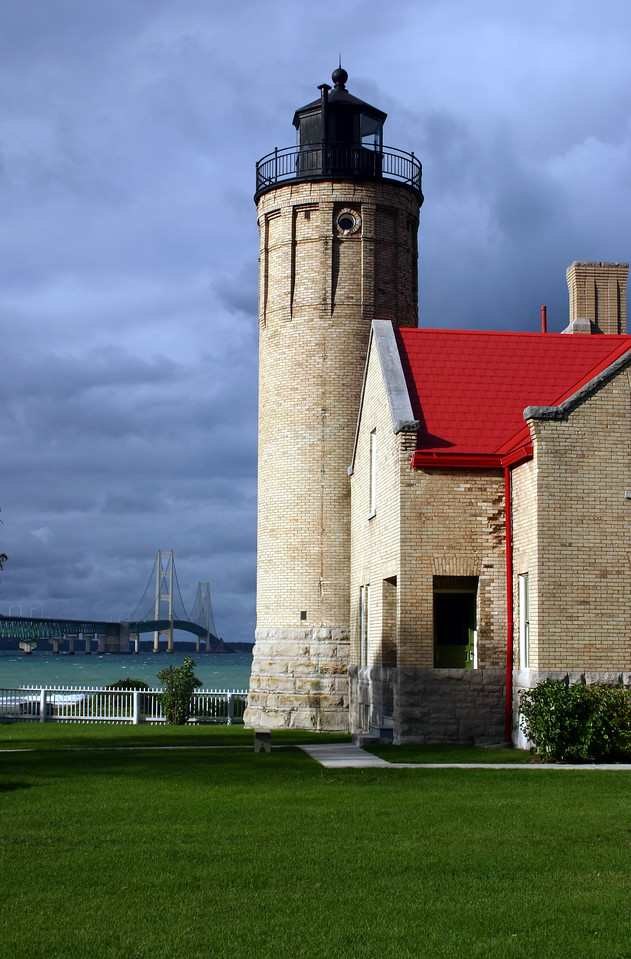With its impressive buff-colored brick walls, large square tower topped with battlements, and elegant fourth order Fresnel lens, this lighthouse-built in 1892-is a source for inspiration. And then there's the backdrop: Sparkling beach sand, the majestic Straits of Mackinac, and the magnificent Mackinac Bridge, acting as a vista connecting the past, present, and future.  Climb the tower and breathe in the spectacular view as generations of lighthouse keepers did before you. Step inside the lighthouse, and hear the Victrola play pre-World War I tunes in a period-styled sitting room. Explore nighttime navigation and Great Lakes' shipwrecks. Interact with hands-on exhibits. Ask questions. Immerse yourself.  Inside this stately structure, it's always 1910, so welcome and discover. Located in Mackinaw City.