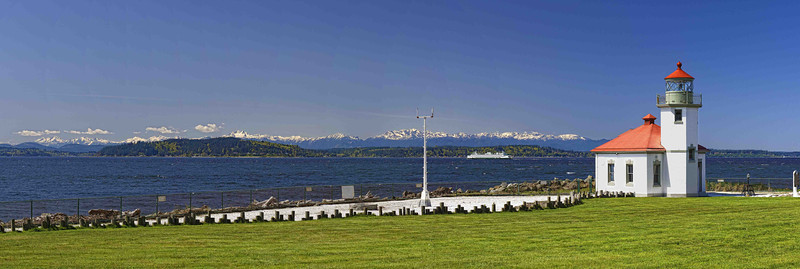 """Alki Panoramic"" A crystal clear spring day shows the entire Olympic Range, the old Alki Lighthouse and the Seattle-to-Bremerton ferry crossing Puget Sound."