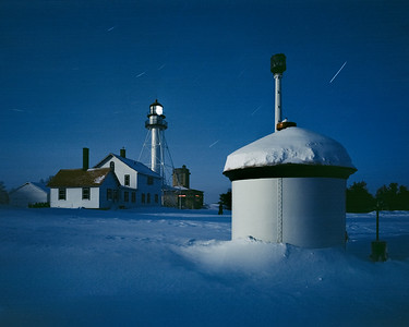 Whitefish Point Lighthouse under a fresh coating of powder and lit by a full moon