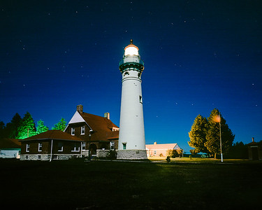 Seul Choix Point Lighthouse lit by a full moon 2012