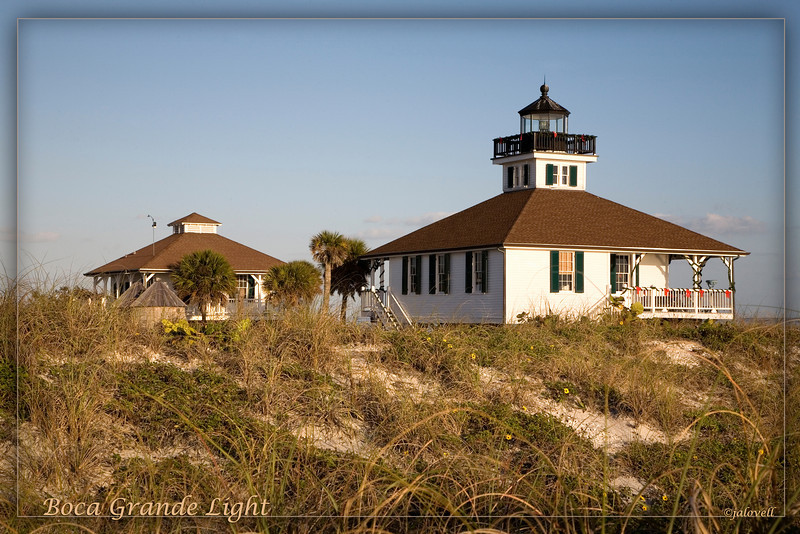 Boca Grande Light sits on rolling dunes dotted with pretty yellow wildflowers by the Gulf of Mexico on Florida's west coast.
