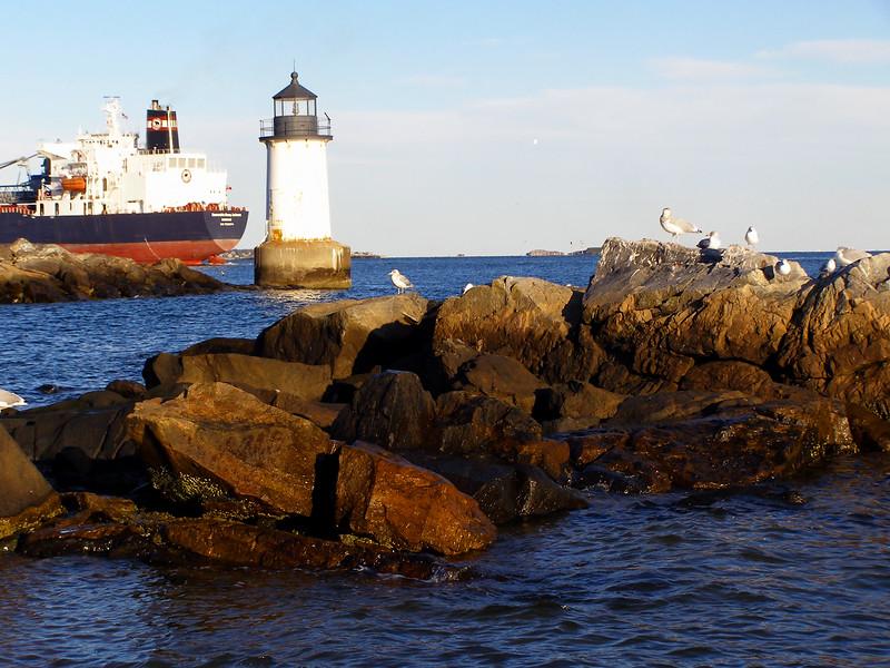 Lighthouse on the coast, Salem, Massachusetts. Tanker in distance.