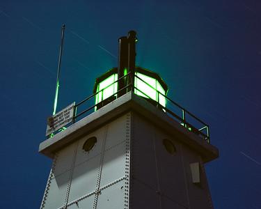 Ludington North Breakwater Lighthouse under full moon light and star trails