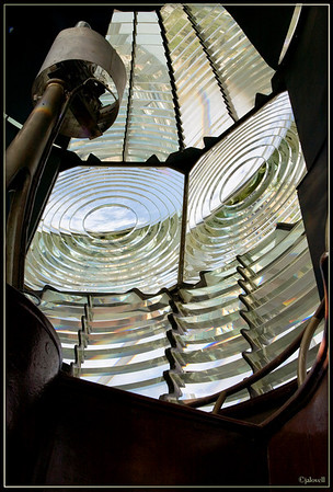 Jupiter Light Fresnel Lens - a parabolic type lens invented by French physicist Augustin Fresnel.  First Order lenses such as this are the largest at 12 feet tall with a diameter of 6 feet and a focal length of 36 inches. This state-of-the-art first order Fresnel lens was made by the Henry Lepaute Company of Paris.  The holder for the two 1000W light bulbs can be seen within.