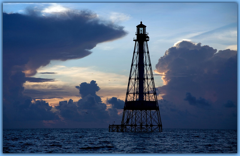 Alligator Light...............Islamorada, Florida<br /> The inky black of a stormy predawn morning fades as clouds part and the sun begins its ascent.