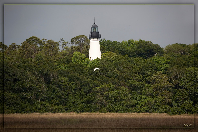 Amelia Island Light-located on a bluff overlooking marshland as viewed from Ft. Clinch State Park