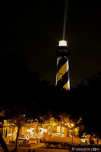 St. Augustine Lighthouse at night with holiday lights.  The beam is courtesy of a windy, misty nor'easter.