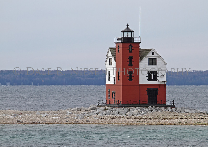 """Round Island Lighthouse in the Straits of Mackinac (Lake Huron) near Mackinac Island, Michigan. This lighthouse was used in several scenes in the 1980 movie """"Somewhere in Time"""" with Jane Seymour and Christopher Reeve."""