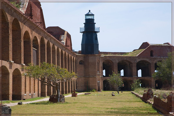 View of the light from inside the hexagonal fortress walls. The view shows the lighthouse to be a three story structure.