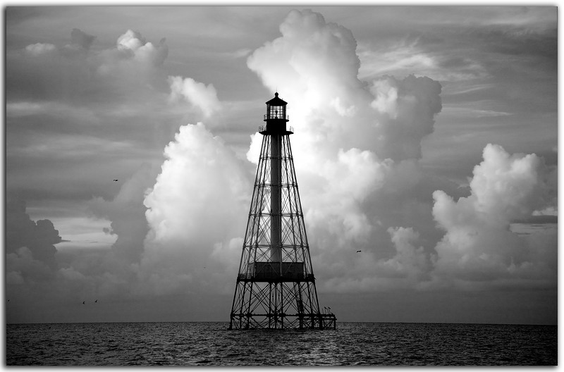 Alligator Reef Light...........................Islamorada, Florida<br /> Light and shadow play on magestic clouds at dawn.