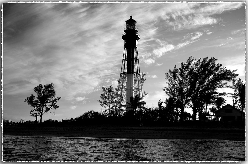 Hillsboro Light is situated at the entrance of the Hillsboro Inlet in Deerfield Beach, Florida<br /> This black and white photograph was taken late in the afternoon from the Atlantic side.