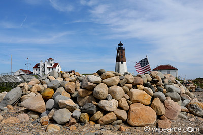 Judith Point Lighthouse and Coast Guard Station.  Rock memorial on the beach.  Judith Point, RI