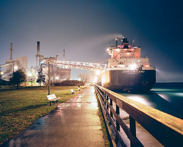 """The John J Boland (2) unloading a shipment of coal on a rainy December night at the Wyandotte Municipal Powerplant. Wyandotte Michigan. Taken from the Bishop Park waterfront.  *For information on purchasing prints and canvas gallery wraps, click the """"Purchasing"""" tab at the top of the page. If viewing on your mobile device, scroll to the bottom of the page and click the """"Full Site"""" tab to view as if you were on your home PC and then go to the """"Purchase"""" tab to for purchasing info. In mobile mode, you will not see the standard navigation bar with the """"Purchase"""" tab."""