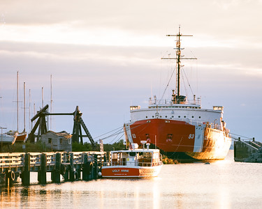 """The US Coast Guard Cutter  Mackinaw and the Ugly Anne docked at the old car ferry dock in Mackinaw City  *For information on purchasing prints and canvas gallery wraps, click the """"Purchasing"""" tab at the top of the page. If viewing on your mobile device, scroll to the bottom of the page and click the """"Full Site"""" tab to view as if you were on your home PC and then go to the """"Purchase"""" tab to for purchasing info. In mobile mode, you will not see the standard navigation bar with the """"Purchase"""" tab."""