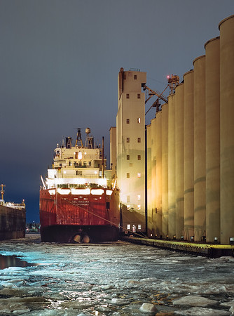"Niagra of the Canadian Steamship Lines chomping at the bit to bust out of her winter layup at the Cargill Elevators in Sarnia Ontario. March 2015  *For information on purchasing prints and canvas gallery wraps, click the ""Purchasing"" tab at the top of the page. If viewing on your mobile device, scroll to the bottom of the page and click the ""Full Site"" tab to view as if you were on your home PC and then go to the ""Purchase"" tab to for purchasing info. In mobile mode, you will not see the standard navigation bar with the ""Purchase"" tab."