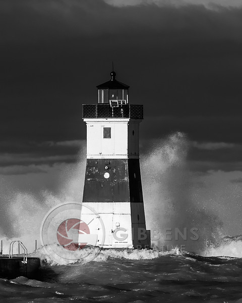 North Pier Light House With Large Wave Crashing