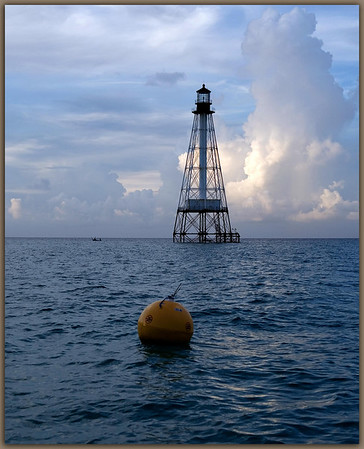 Alligator Reef Light................Islamorada, Florida<br /> <br /> The yellow buoy marks an area of restricted harvesting.