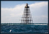 Sand Key Lighthouse: Located about 8 miles SW of Key West. Picture shows a mooring buoy which boaters can tie up to for snorkeling or diving.