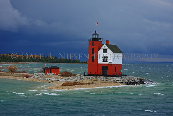 """Round Island Lighthouse in the Straits of Mackinac (Lake Huron) near Mackinac Island, Michigan. This lighthouse was used in several scenes in the 1980 movie """"Somewhere in Time"""" with Jane Seymour and Christopher Reeve. This photo was taken on October 26, 2008 which was a stormy day in the straits it was cold, windy with a rain and hail mix at times."""