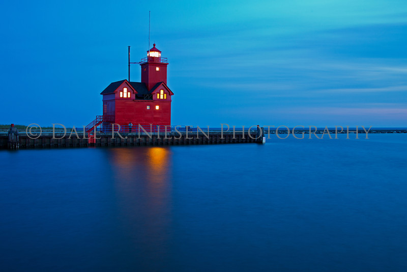"""Holland Harbor Light """"Big Red"""" is located on Lake Michigan at the Holland State Park, Holland, Michigan."""