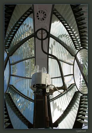Hillsboro Light Stations 2nd Order Bi-Valve Fresnel Lens with source of illumination.