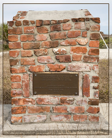A monument made of bricks from the original Canaveral light. located near the spot the lighthouse was moved from.