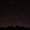 Big dipper over the Tetons with shooting star.