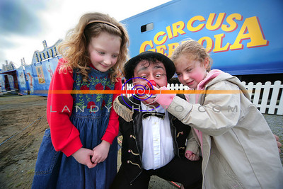 Sarah Mulvihill (7) and Grace O Connor (5) playing games with Mikey the Clown of Gerbola circus that was in Listowel this week. Photo Brendan Landy